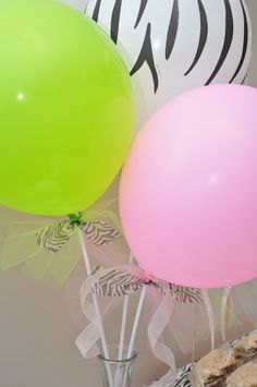 balloons tied to sticks for centerpieces
