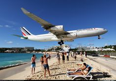 Air France - Maho Beach, St. Maarten - lie on the beach and watch planes land! Love it! Via @JohnnyJet