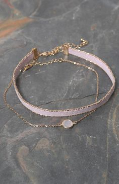 Sweet, feminine style is granted in this choker set from LA Hearts. This set…