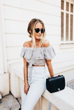 Off the shoulder crop + high waisted denim.