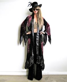 """Rock Goddess inspired kimono duster! Insanely gorgeous luxe crushed velvet burnout. Stunning large scaled floral pattern in shades of rose, burgundy and forest green. Edges are finished in black satin with a high low hemline. Amazing dramatic kimono sleeves. TIes on inside at waist. Can be worn open or belted. One Size fits AllBust up to 44""""Shoulder 18""""Length at center front 44""""Length at center back 48""""The velvet burnout process, or """"..."""