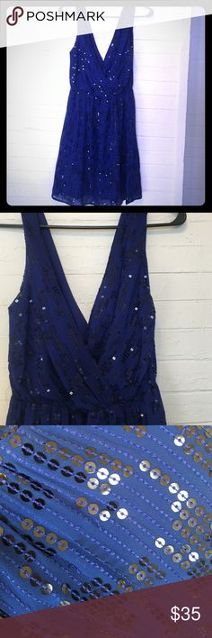 Express double v neck sequined mini dress Beautiful blue short dress with black sequins. Worn once to a wedding reception. Front and back cross over v neck. Has snap closures inside straps to hide your bra straps. Express Dresses Mini