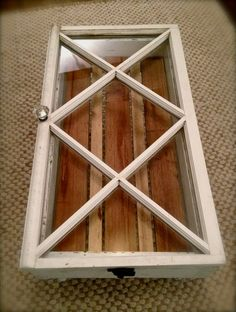 """Coffee table made from a pretty rare window with diamond shaped panes which opens up for storage. Each one of these tables is one of a kind. The table itself is made from new 2"""" x 6"""" studs. Interior shelf is made of rough cut 1""""x4"""" and 1""""x2"""" cedar board in contrasting shades to add interest. All reclaimed hardware is used whenever possible, with the exception of new sash locks on both sides. This one features a vintage crystal door knob to make it super classy!    Dimensions:  34""""l x 18""""w x 15""""h"""