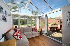 Inside of a Gable Front Conservatory with a glass roof and Bi Fold Doors. Beautiful.