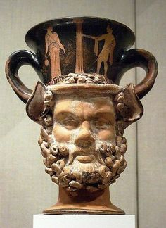Terracotta kantharos (drinking cup with two vertical handles): heads of a satyr and a woman  Greek, Attic, red-figure, ca. 420 BC  Metropolitan Museum of Art