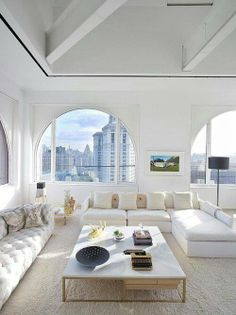 Penthouse White House white walls, white sofas artistic statement, however how livable it would be especially with kids or dog or anyone drinking coffee.tea or red wine!! I can image the dog hair! Careful what you wish for