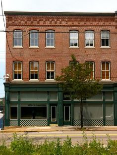 Image result for brick building with storefront