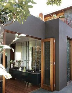 indoor/outdoor bathroom... wood floor meets dark stone, like outdoor house color (maybe a few shades lighter)