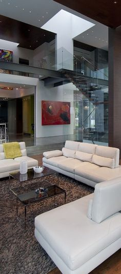 Living Room - Natural light in a modern contemporary setting where structural becomes the architectural bones of an open concept design. Glass walls and a white canvas punctuated with vibrant art (re-pinned photo only Whipple Russell Architect)