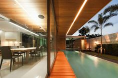 http://www.inmagz.com/ architecture amazing l residence in bangkok by office at dinning area with glass wall opens to swimming pool f