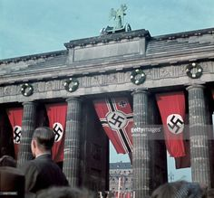 The German War Flag hangs boldly from the central arch of the Brandenburg Gate as part of the grandiose victory celebrations for the German Reich's rapid and unprecedented triumph over France in the Summer of 1940. Berlin, German Reich. July 18th, 1940.