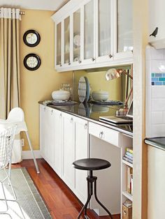 Space maximized: Built-ins hold dishware and also serve as a small office nook.