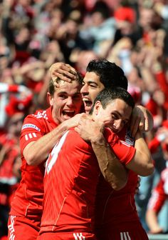 Luis Suarez celebrates with Jordan Henderson and Stewart Downing as he scores their first goal during the FA Cup with Budweiser Semi Final match between Liverpool and Everton at Wembley Stadium on April 14, 2012 in London, England.