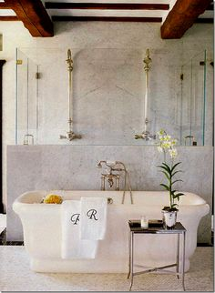 marble and glass enclosed shower behind the tub - Renea Abbot - via cote de texas