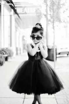 just so cute. she reminds me of a little Audrey Hepburn in Breakfast at Tiffany's