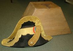 French Napoleonic Naval Officers Cocked Hat. Late 18th Century, Early 19th Century High Ranking Officer. Broad Gilt Lace Trim, Triple Gilt Lace Loop with Simulated Pull Button. Paper Lined Wooden Case (Some Old Worm) with Thin Iron Clasp and Carry Handle. Rare Item.