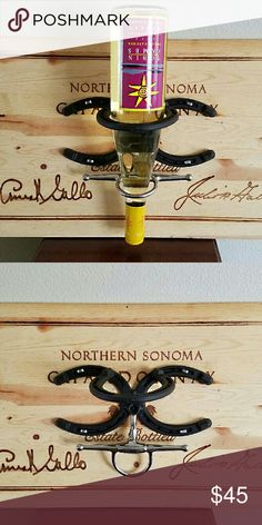 Perfect Horseshoe wine bottle display Perfect Horseshoe wine bottle display. Horseshoes and bit mounted on the lid of an old wine bottle box.  No, sorry. Wine bottle not included. ;-P spoon Me Baby Designs  Other