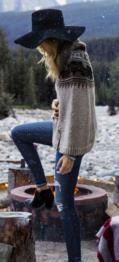 love everything about this outfit. ankle boots ((would be cuter if they were flats but okay)), slightly ripped blue jeans, soft grey sweater with Scandinavian pattern on the top, and last but not least, the classic floppy hat.