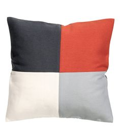 Cushion cover in woven fabric with a color-block front section, solid color at back, and a concealed zip. Size 20 x 20 in.
