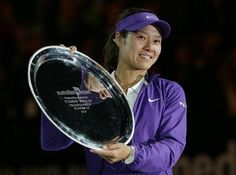 China's Li Na holds up her trophy after losing to Victoria Azarenka of Belarus in the women's final at the Australian Open tennis championship in Melbourne, Australia, Saturday, Jan. 26, 2013. (AP Photo/Aaron Favila)