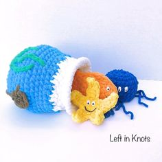 Stuff and Spill Fish Bowl — Left in Knots Babies and toddlers will love this fun 'stuff and spill' toy! Made with Bernat Blanket yarn-it is super soft, super plushy and super cute! #crochet #babytoy #diy #crochettoy #fishbowl #bernatblanketyarn @yarnspirations