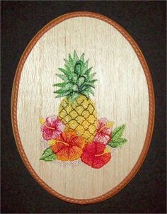 This uniqueTropical Wall Dcor Pineapple Embroidery Wood Art combines the warmth of wood with the raised texture of 21 different thread colors and 33,905 stitches. The design was machine embroidered into a sheet of balsa wood, then cut and mounted on an oak stained 9 x 7 x 1 plaque. The tan leather braided trim was added before a clear protective, non-yellowing acrylic matte finish was applied. A brass hanger is attached to the backside making it ready for hanging.    Balsa Wood Embroidery is…