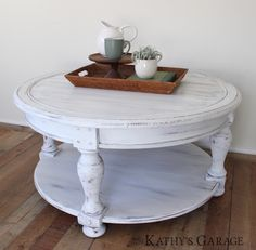 With a shiplap style top and turned legs, this round coffee table carries a farmhouse feel. Finished in a true white, this is sure to compliment any living room while also livening the space. This table has been slightly distressed, revealing warm wood undertones and giving it a whitewashed look. Measuring just over 3' wide, this table offers plenty of room for gathering the masses around drinks or a board game.