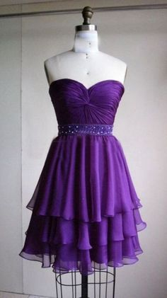 Strapless purple tiered after 5 dress with sheared bodice.