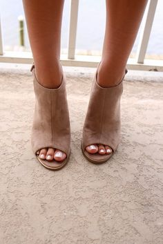 Classic taupe heel booties. Buckles on sides. Heel Height is 4in
