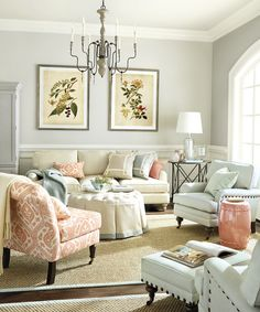Coral blends perfectly with mineral blue in a formal living room