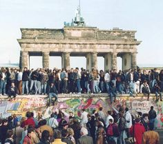 Photograph:People gather in front of the Brandenburg Gate to celebrate the opening of the Berlin Wall in November 1989. In October of that year, East Germanys hard-line communist leadership had been forced from power during the wave of democratization that swept through Eastern Europe.