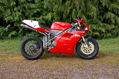 DUCATI 996 SPS - The SPS was a very racy version of the 996.  It included hotter cams for more power as well as lightened, higher spec Ohlins suspension components.  The SPS as well as the 'R' version are the most prized of the 996 models.  This one pictured has aftermarket wheels.