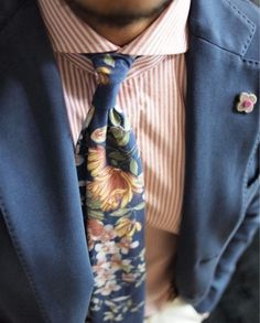 Floral tie with pink shirt, and blue jacket