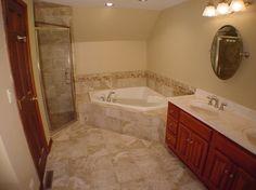 bathroom design with corner tub & adjacent shower