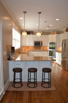 After: Modern elements mix with industrial to create an updated, transitional kitchen.