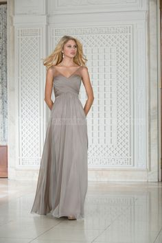 Jasmine Bridal Bridesmaid Dress Belsoie Style L174002 in Taupe. An elegant Tiffany chiffon bridesmaid dress that can find a place at any wedding. This dress has a V-neck neckline, an A-line skirt and ruching on the bodice and beading on the straps. A stylish and elegant choice for your bridal party.