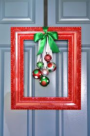Framed Christmas Wreath. A great alternative to the traditional evergreen wreath. Glossy painted frame with ribbon and ornaments hanging in the center. Adorably adaptable for lots of holidays!