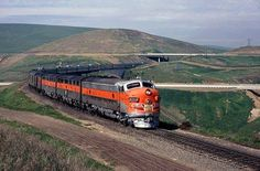 Western Pacific's  California Zephyr passes beneath Highway 50 on Altamont Pass in March of 1970. Drew Jacksich photo.