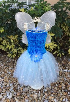 Frozen Blue Tutu Dress, Frozen Blue fairy Wing Dress Up Set, Blue Tutu Top, Princess Party Favors, Tinkerbell Party Favors,, $26.00. Also check out my other cute frozen theme items. www.partiesandfun.etsy.com