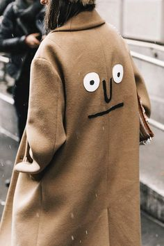 camel colored coat with a felt face on it, so cute!