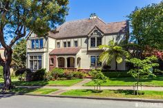Grand Tudor-style residence on prestigious tree-lined Blvd. in St. Francis Wood. Designed by prominent architect Alfred Henry Jacobs. Features gracious living rm with Baronial fireplace, formal dining rm with sitting area, remodeled spacious kit. with garden view dining area, br and full bath all on 1st level. Beaut. crafted staircase leads to 2nd level with 4 BR 2 ba including master suite.