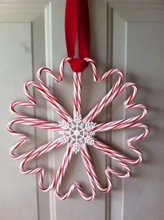 Candy cane wreath Saw this and thought it was adorable & inexpensive to make!