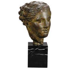 Sculpted Bust of Greek Goddess Mounted on Marble Base | From a unique collection of antique and modern busts at http://www.1stdibs.com/furniture/more-furniture-collectibles/busts/