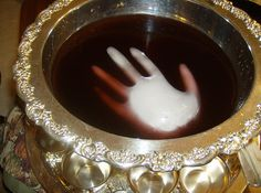 Fill a glove with water and freeze. Remove ice from glove, and add to any dark colored punch for a spooky effect!!