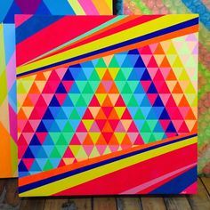 """A few touch-ups on this #crazy #colorful #painting """"Spectrum"""" before it goes to a #collector #nofilter! 😂🌈💥 #queenandrea #geometry #fineart #popart #dynamic #color #interplay #balance #partytime #studiotime #wordlife by queenandreaone..."""