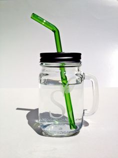"""Mason jar with handle. Includes lid with straw hole and one 8"""" color bent straw! $14.50"""