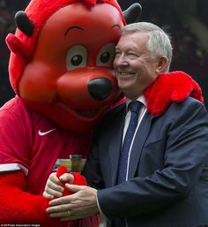 Sir Alex Ferguson is greeted by Fred the Red on the Old Trafford touchline ahead of victory over Norwich in March 2013