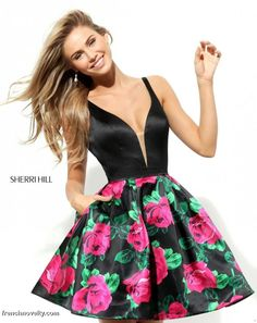 Sherri Hill 50596 is a sleeveless short party dress with a floral skirt and a plunging neckline
