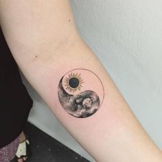 Sun-moon Yin Yang tattoo on the forearm.Done by Hongdam