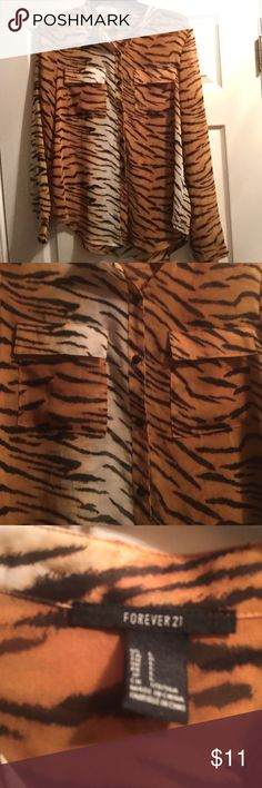Sheer tiger blouse Sheer tiger blouse with two pockets on chest. Fun for a night out. Never worn but has no tag. Forever 21 Tops Blouses